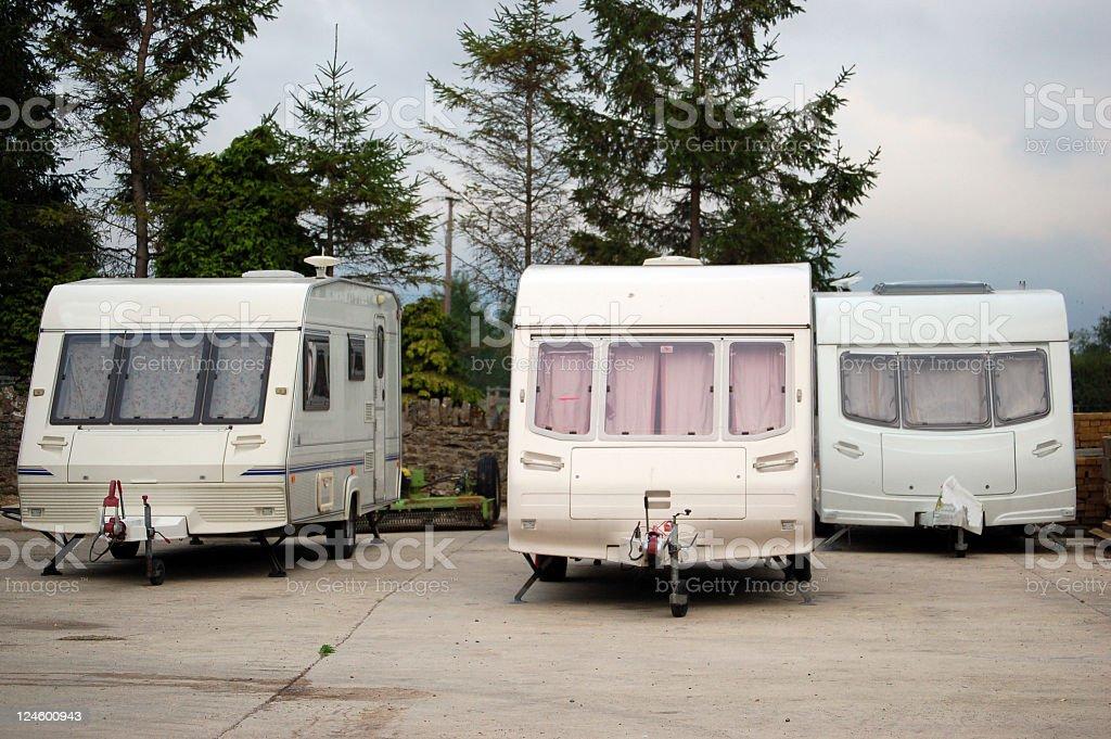 Three Caravans in caravan trailer park royalty-free stock photo