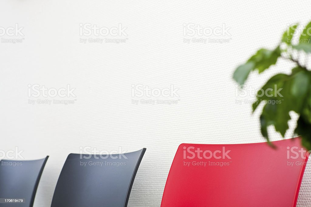Three Chairs and a Plant in Office royalty-free stock photo