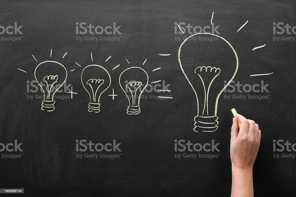Three chalk drawn lightbulbs equal one big lightbulb royalty-free stock photo
