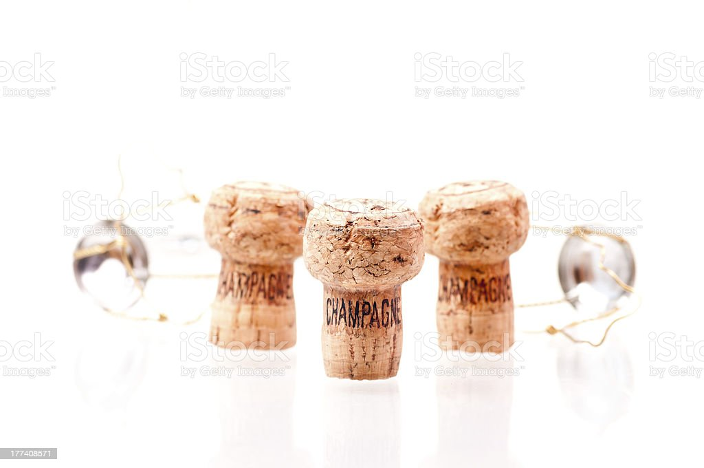 Three Champagne corks in a line stock photo
