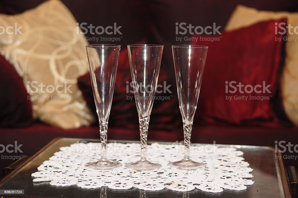Three champagne glass with sofa background stock photo