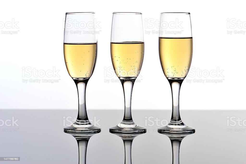 Three champagne/wine flutes royalty-free stock photo