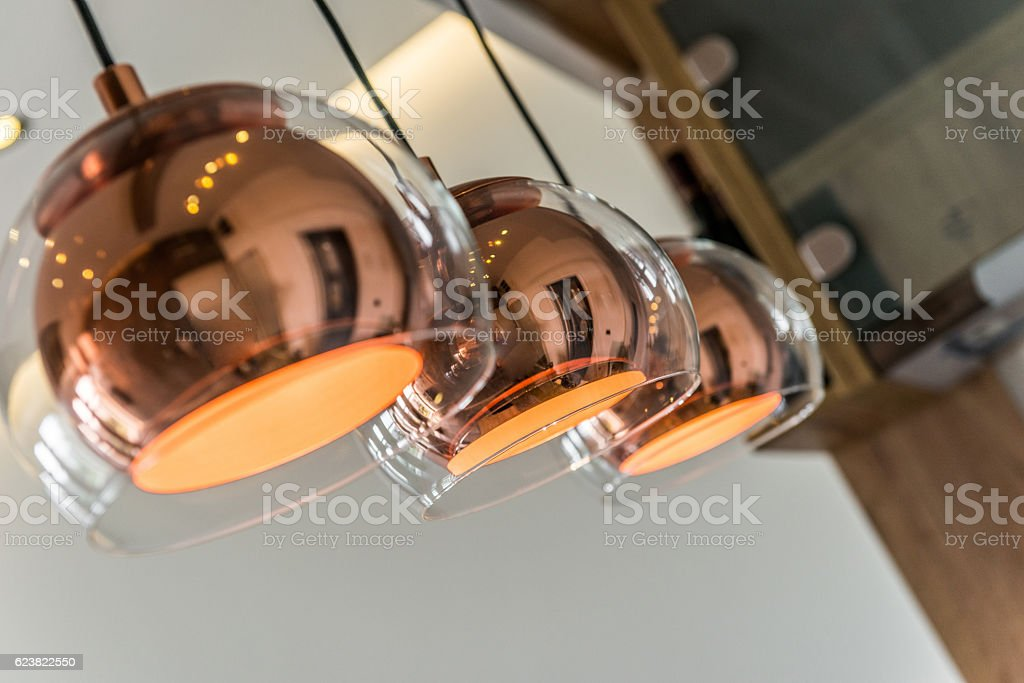 Three chandeliers or lamps in modern home interior stock photo