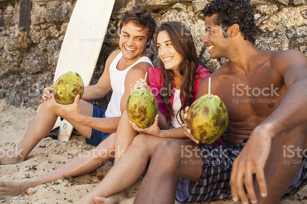 Three cheerful friends have fun together on the beach. royalty-free stock photo