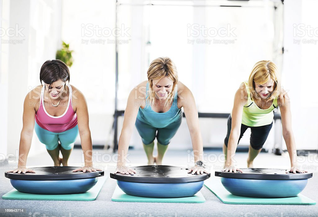 Three cheerful women in push up position royalty-free stock photo