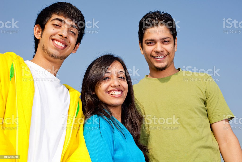 Three Cheerful Young Indian Adult Youth Male Female Standing Outdoor royalty-free stock photo