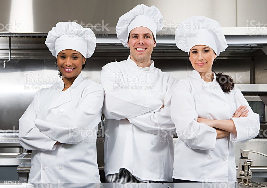 Three chefs stock photo