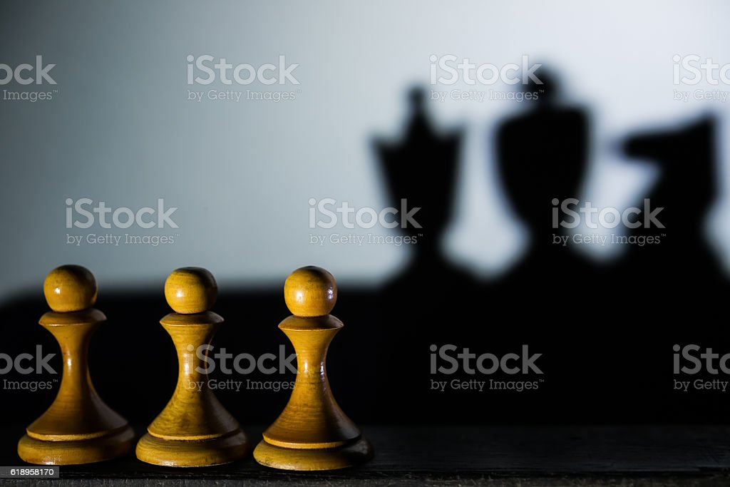 three chess pawn casting Queen King and Knight shadow stock photo