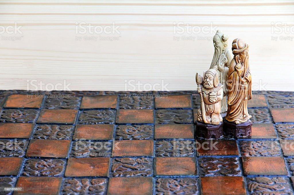 Three chess pieces on a chessboard stock photo