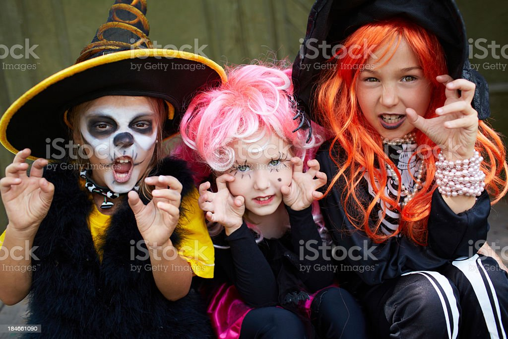 Three children dressed up for Halloween stock photo