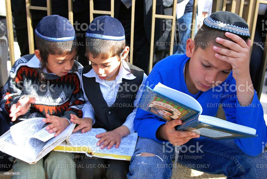 Three Children reading the Bible. stock photo