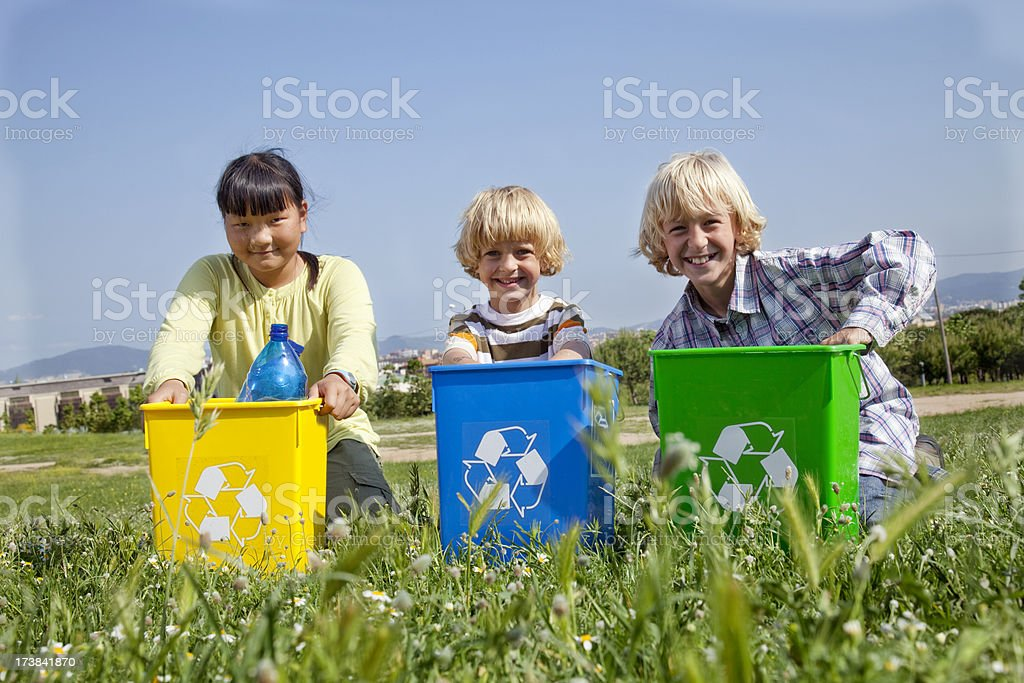 Three children recycling garbage royalty-free stock photo