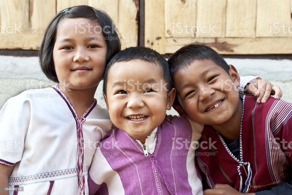 Three children smiling for a photo stock photo