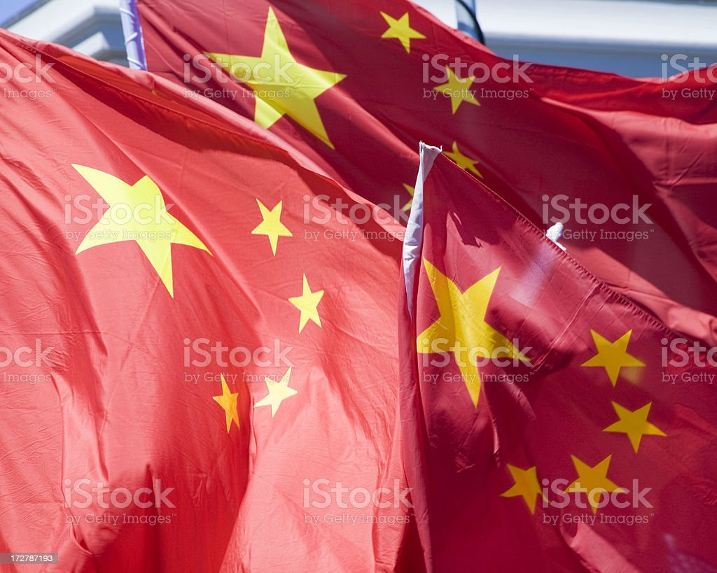 Three Chinese Flags in the Wind stock photo