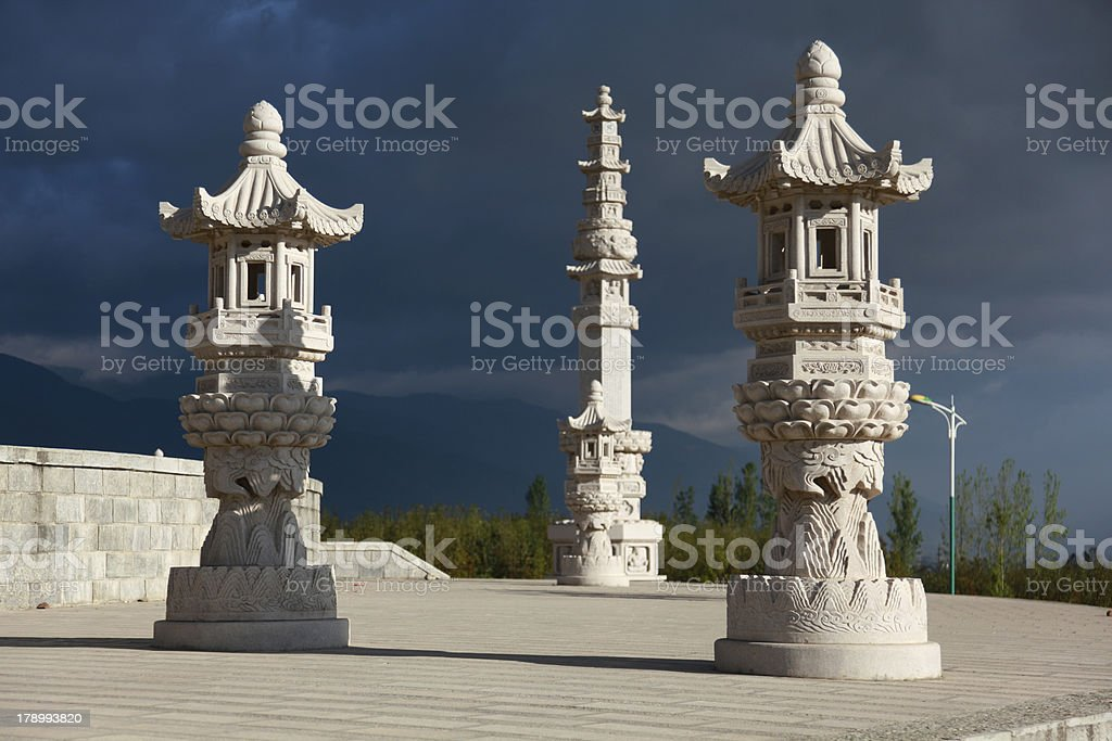 Three chinese style stone lantern with dark cloud royalty-free stock photo