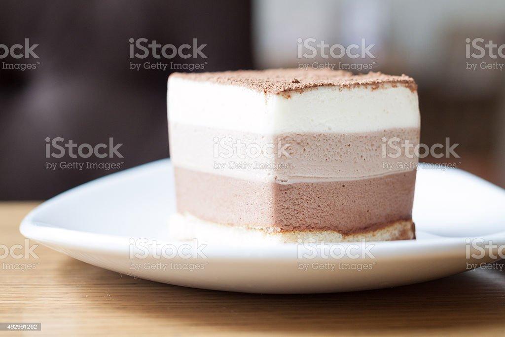 Three chocolate mousse cake slice stock photo