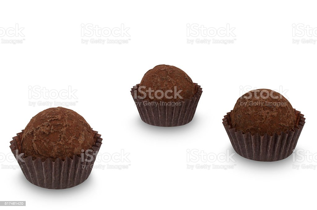 Three chocolate truffle sweets isolated on white background stock photo