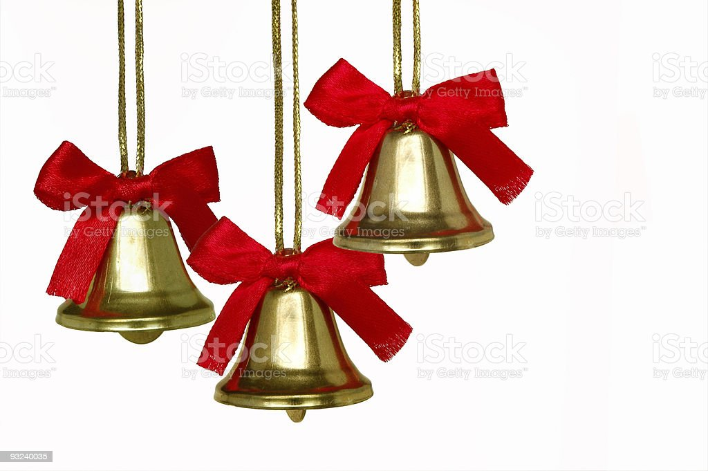 Three Christmas bells with red bows on a white background stock photo