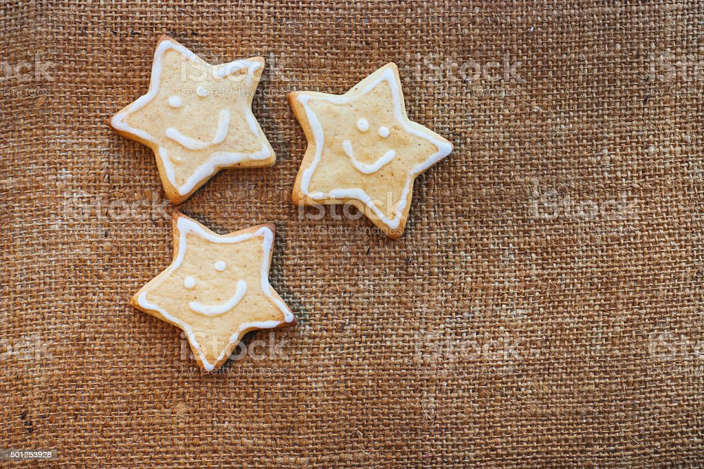 Three christmas cookies on the flax texture stock photo