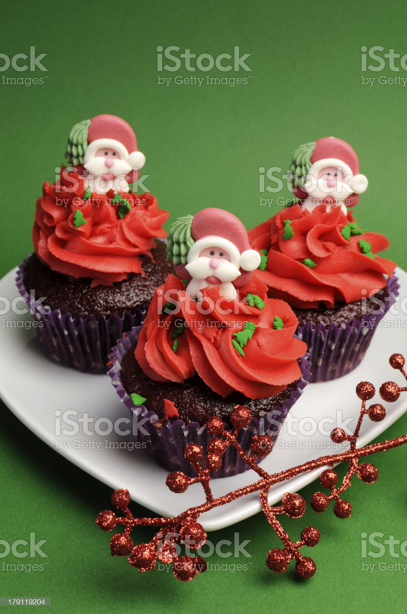 Three Christmas Cupcakes with santa decorations- vertical. royalty-free stock photo