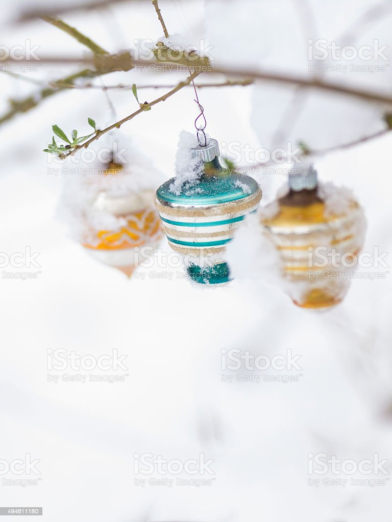 Three Christmast balls on branch with snow for card stock photo