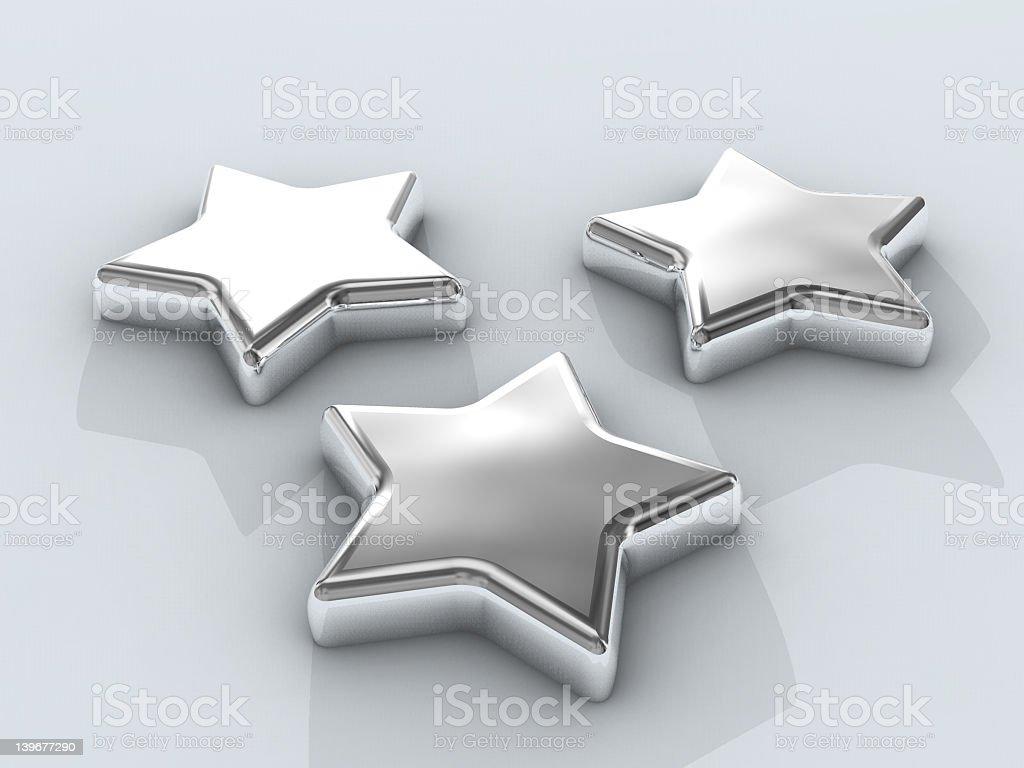 Three Chrome stars stock photo