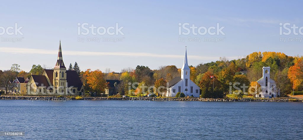 Three churches with autumn colors stock photo