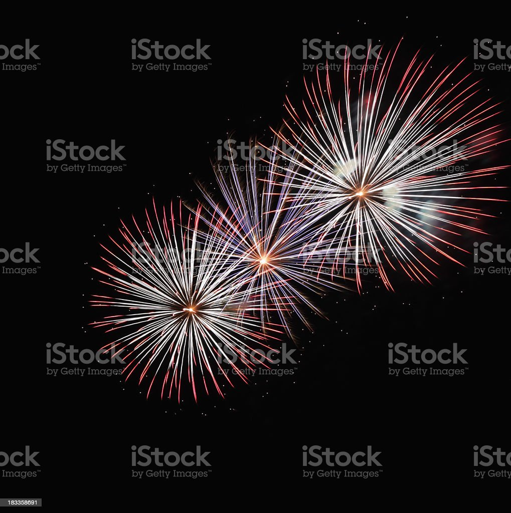 Three Circular Pattern Fireworks Explosions royalty-free stock photo