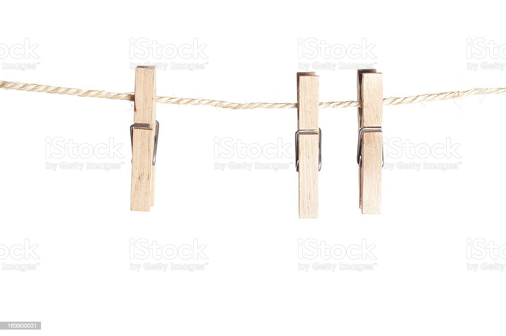 three clamps for laundry hanging on a string royalty-free stock photo