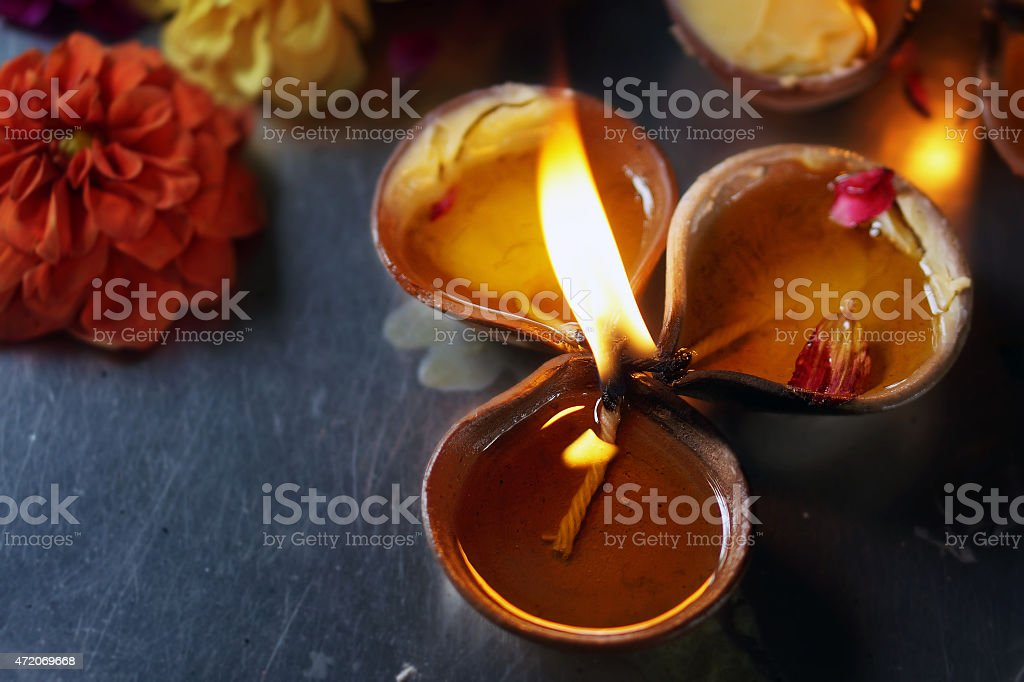 Three Clay Oil Lamp with One Flame stock photo