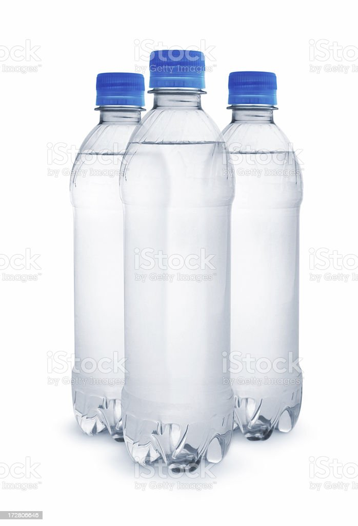 Three clear water bottles with blue screw-tops and no label royalty-free stock photo