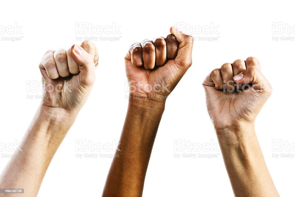 Three clenched female fists triumphantly supporting women's rights stock photo
