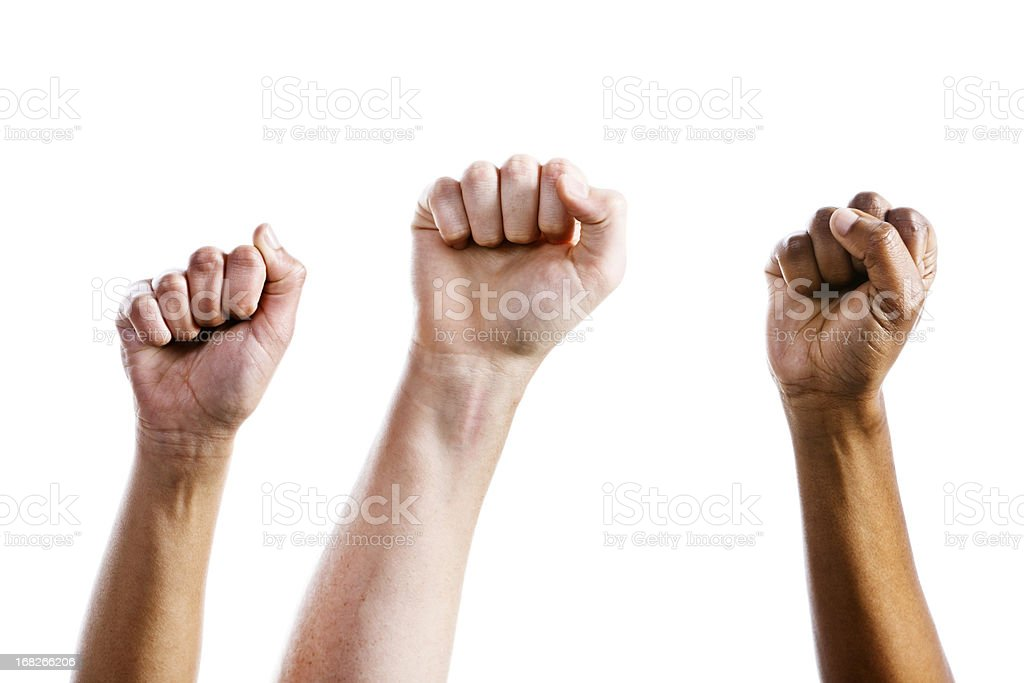 Three clenched fists air punch in triumph or defiance stock photo