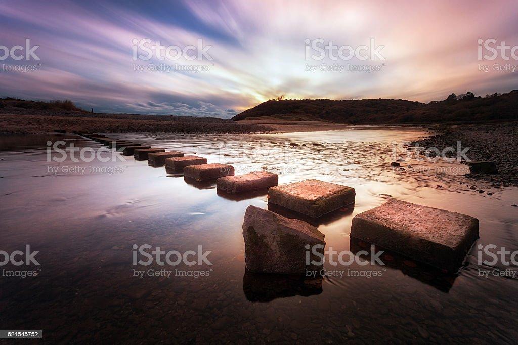 Three Cliffs Bay stepping stones stock photo