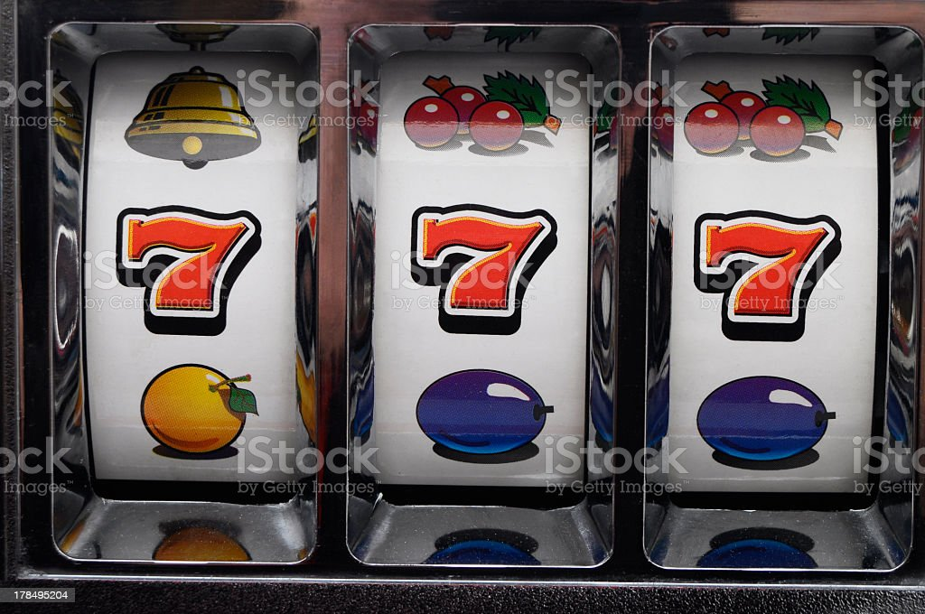 Three close-up red jackpot sevens of slot machine stock photo