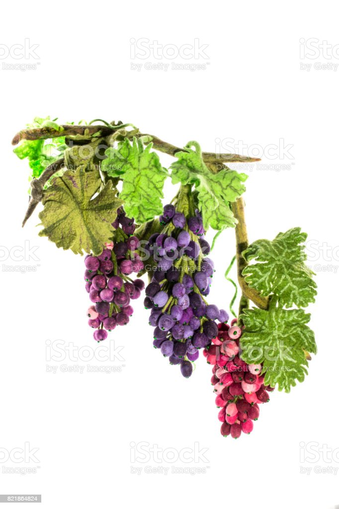 Three clusters of handmade grapes from felted wool on a white background stock photo
