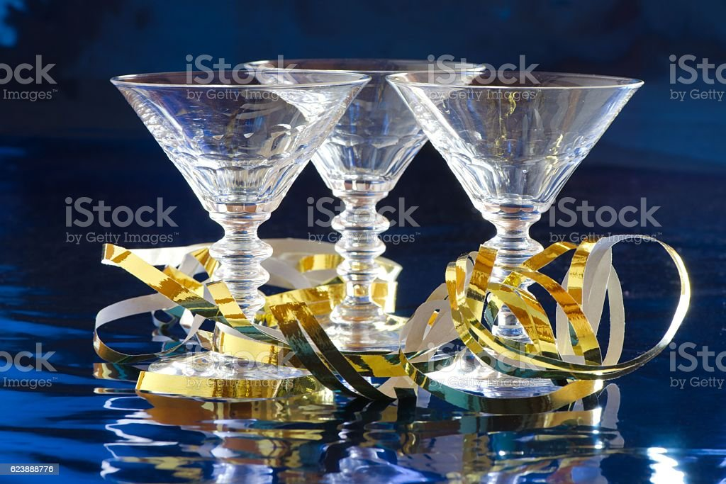 Three cocktail glasses with golden serpentine stock photo