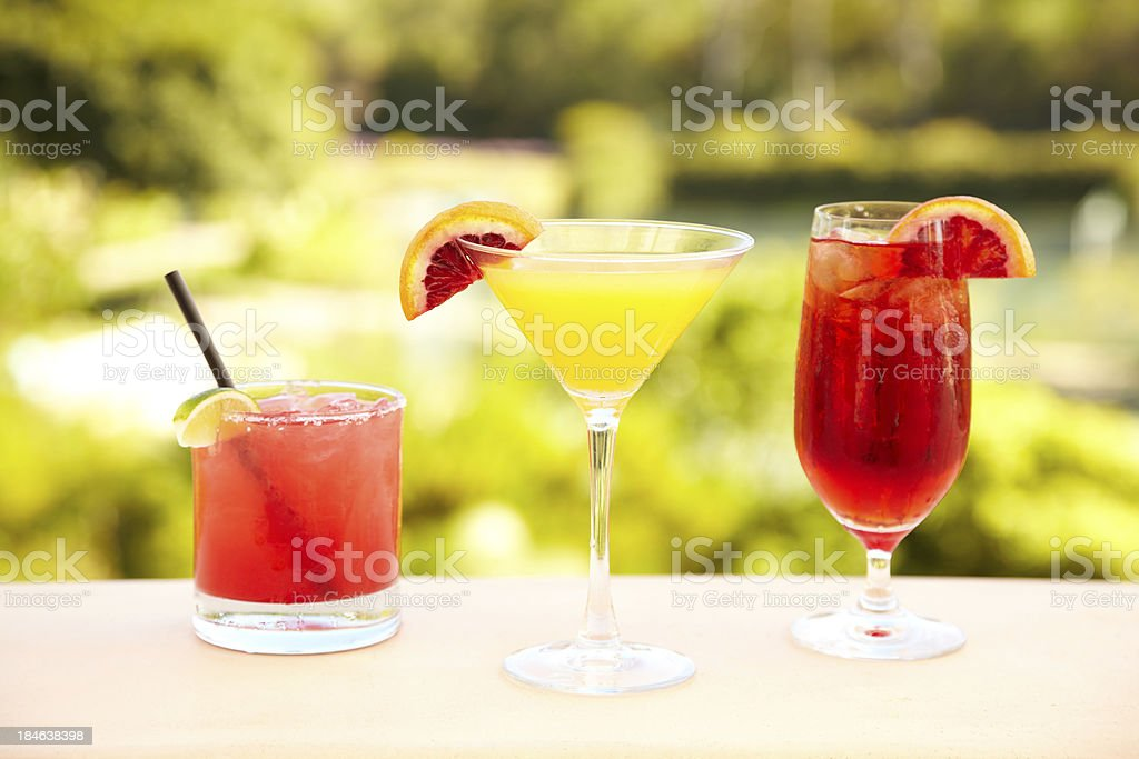Three cocktails at outdoor bar royalty-free stock photo