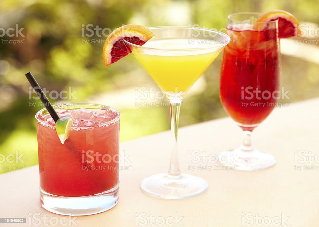Three cocktails at outdoor bar stock photo