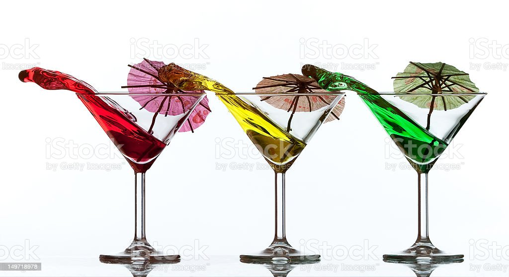 three cocktails with umbrellas splash royalty-free stock photo