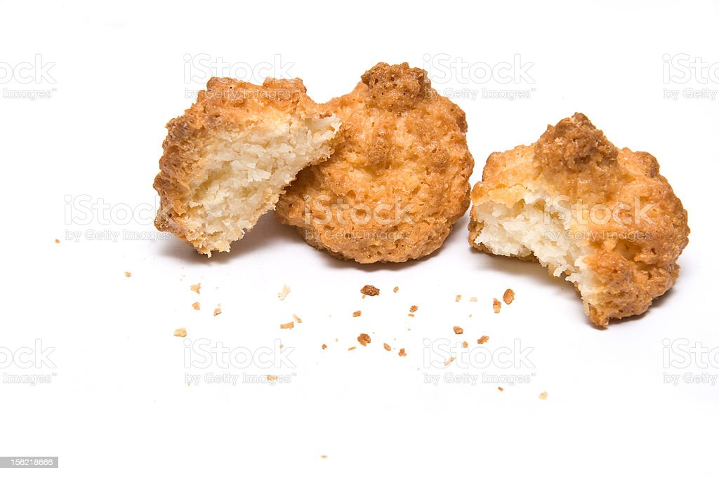 Three coco biscuits with bites and crumbs stock photo