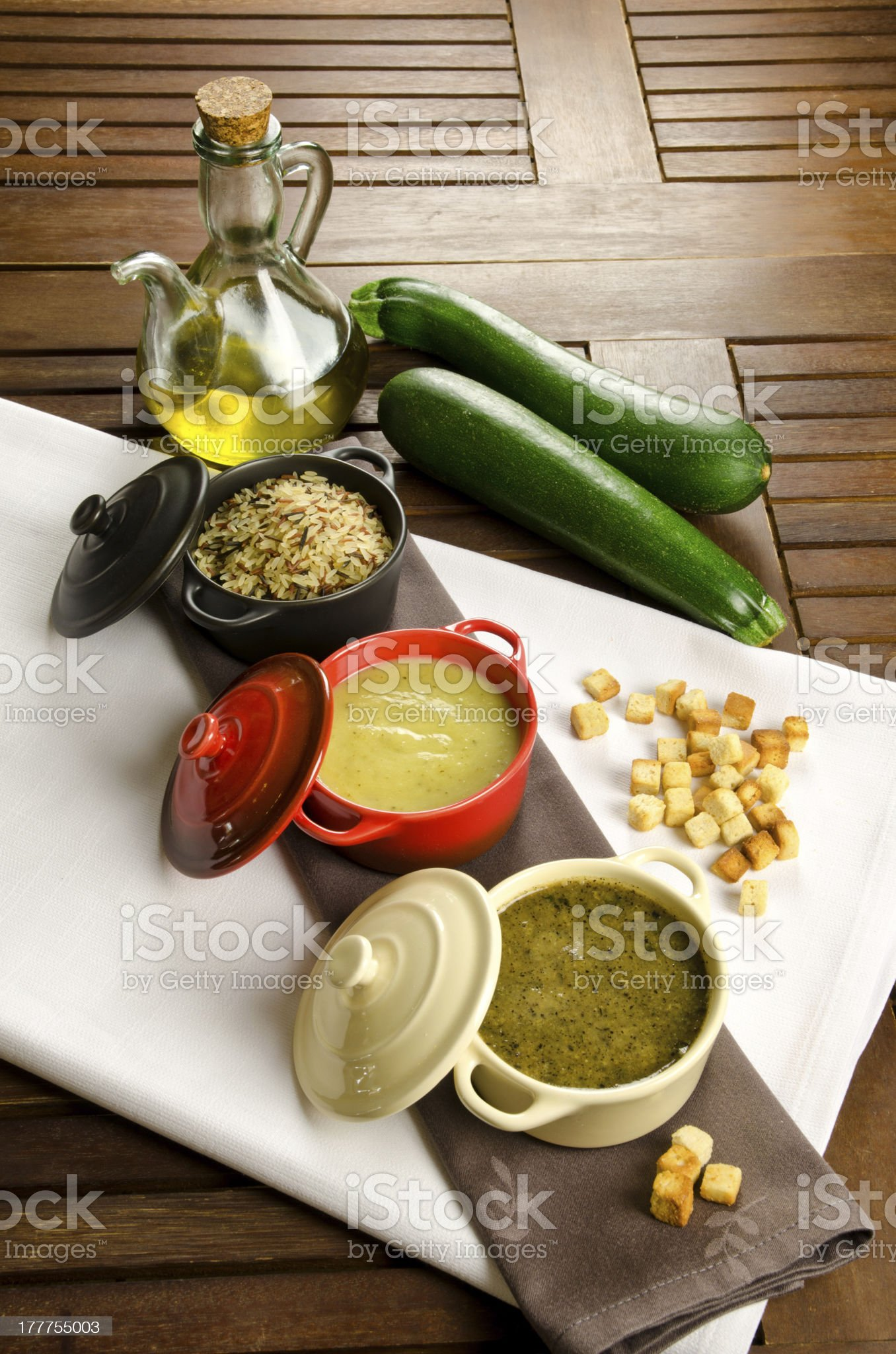 Three cocottes and fresh zucchini royalty-free stock photo
