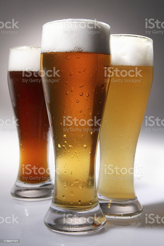 three cold beer glass on grey royalty-free stock photo
