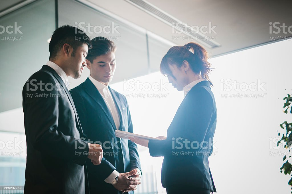 Three Collegues Meet in the Office stock photo