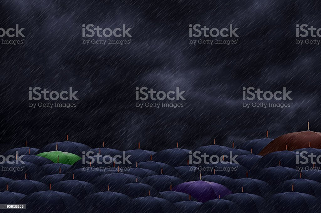 Three color  umbrella mingling with grey umbrellas - Be differen stock photo