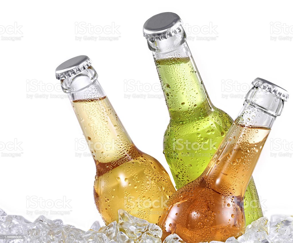 Three differend colored bottles on ice