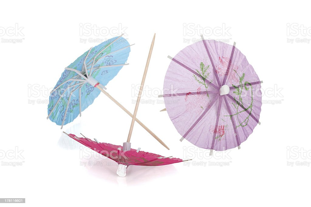 Three colored cocktail umbrella stock photo