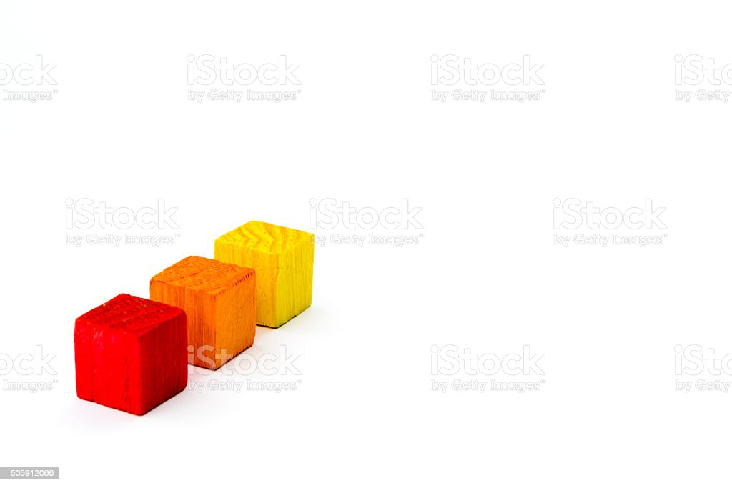 Three colored cubes isolated on white background stock photo