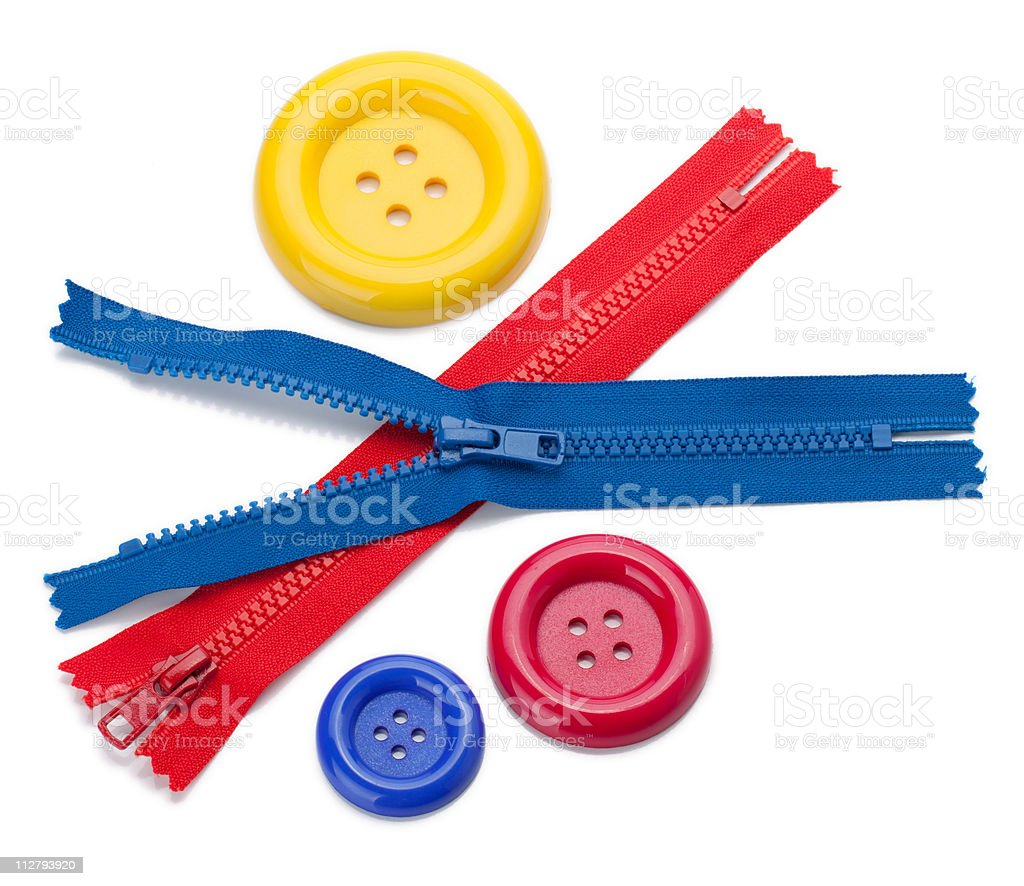 Three colored sewing buttons and two zippers royalty-free stock photo