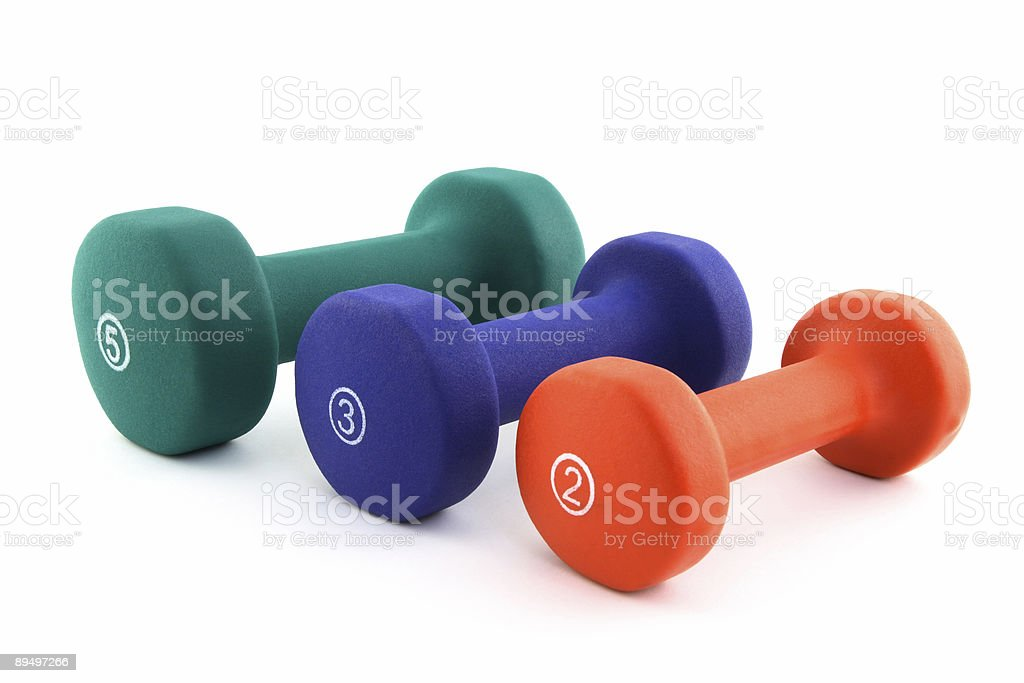 Three colorful dumbbells of different size stock photo